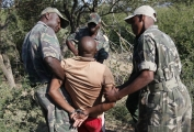 <h5>The War On Elephant Poachers</h5><p>An elephant poacher being taken into custody by African authorities.</p>