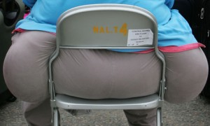 Obese person sitting on chair