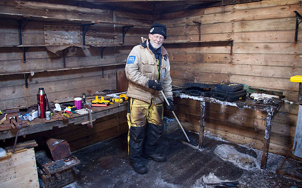 Mawson's Huts expedition conservator Peter Maxwell stands in the workshop section of Mawson's Hut Photo: Reuters